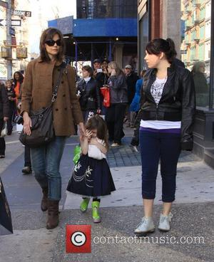 Katie Holmes, daughter Suri Cruise and step-daughter Isabella Cruise walking through New York, on their way to Balthazar restaurant New...