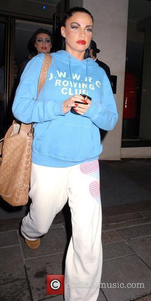 Katie Price, Aka Jordan, Leaving The May Fair Hotel Wearing Sweats and Ugg Boots