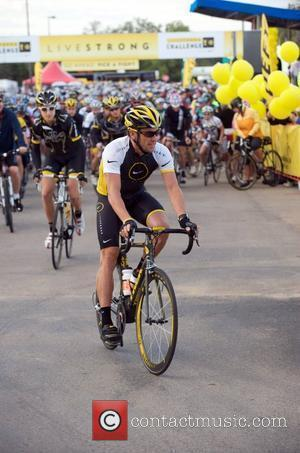 Lance Armstrong cycling at the start of the Livestrong Challenge which is the Lance Armstrong Foundation's signature fundraising event which...