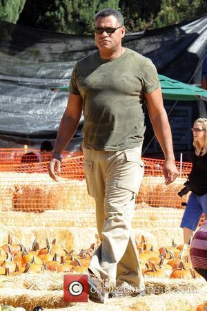 Laurence Fishburne shopping at the pumpkin patch with his family. West Hollywood, California - 17.10.09