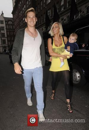 Lee Ryan and his fiancee Samantha Miller pull faces at photographers while out and about with their son Rayn Amethyst...