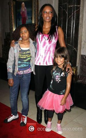 Melanie Brown with her daughters Phoenix Chi and Angel Iris The opening night of 'Legally Blonde' the musical at the...