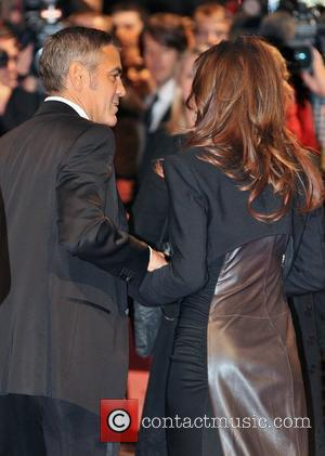 George Clooney and Elisabetta Canale The Times BFI London Film Festival: Fantastic Mr Fox - opening gala held at the...