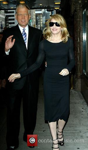 David Letterman accompanies Madonna outside Ed Sullivan Theatre after she taped a segment for the 'Late Show With David Letterman.'...