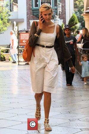'Taken' co-star Maggie Grace talking on her cellphone while out shopping in Hollywood Los Angeles, California - 20.08.09