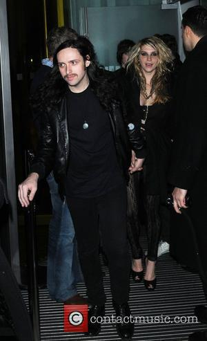 Kesha attends Mahiki's third birthday party, she leaves holding hands with a man and goes onto Bungalow 8 London, England...
