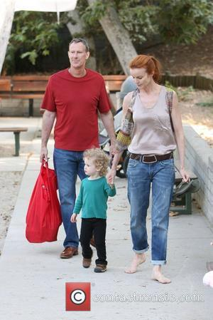 Marcia Cross, Tom Mahoney Take Their Twin Daughters Eden and Savannah To The Park