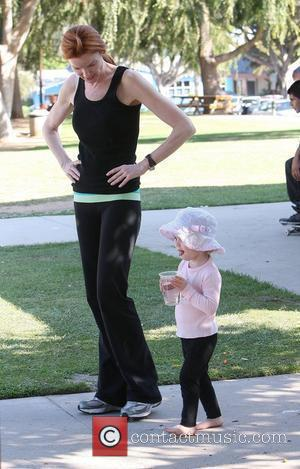 Marcia Cross visits a park in Santa Monica with her twin daughters Eden and Savannah Santa Monica, California - 23.07.09