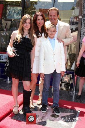 Mark Burnett with his wife, Roma Downey, and their children Hollywood television producer Mark Burnett honored with the 2387th star...