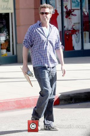 Matthew Perry holding a notebook while out and about in Beverly Hills Los Angeles, California - 25.11.09