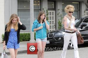 Melanie Griffith and her two daughters, Dakota Johnson and Stella Banderas, leaving Neil George salon in Beverly Hills Los Angeles,...