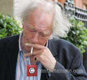 Michael Gambon smoking a cigarette (or weed)
