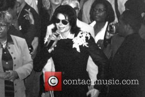 Michael Jackson is honored with high school diploma from Roosevelt High School Indiana, USA - 11.06.03