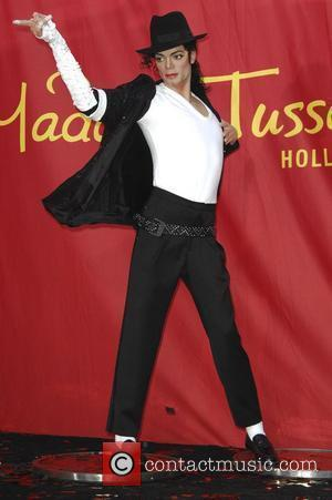 A wax figure of Michael Jackson is seen at Madame Tussauds in Hollywood, California, during a public unveiling ceremony, two...