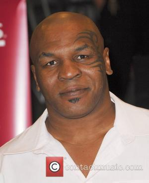 Tyson: 'I'd Like To Sit Down With Holyfield'