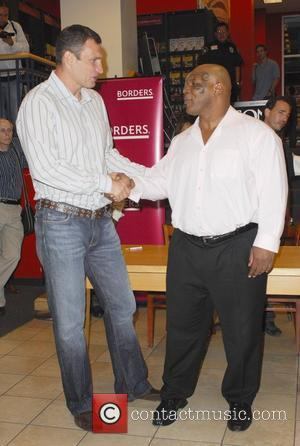 Vitali Klitschko, Mike Tyson signing copies of the Blu-ray and DVD 'Tyson' at Borders Sunset & Vine Los Angeles, California...