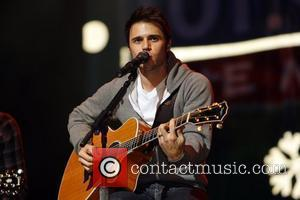 Kris Allen  performs live in concert at WTMX 101.9fm Chicago's Miracle on State Street 11 at the Auditorium Theater...