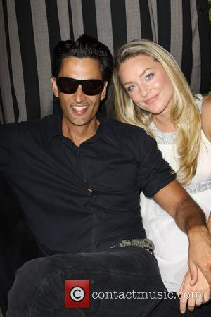 Elisabeth Rohm and husband Ron Wooster