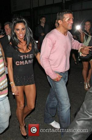 Katie Price and Alex Reid leaving Movida through the back door where they celebrated his cage-fighting victory earlier in the evening.