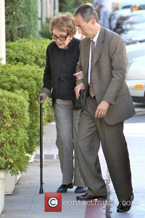 Nancy Reagan Former First Lady Nancy Reagan arriving at a nail salon with the help of a Secret Service agent...