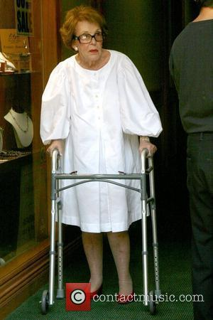 Nancy Reagan  former First Lady of the United States leaving a medical building with the aid of a walker...