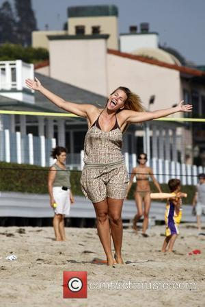 Natasha Henstridge poses for pictures as she enjoys a day on Malibu beach Los Angeles, California - 23.08.09