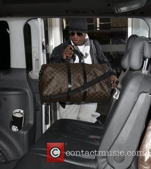 Ne-Yo leaves his London hotel London, England - 06.12.09