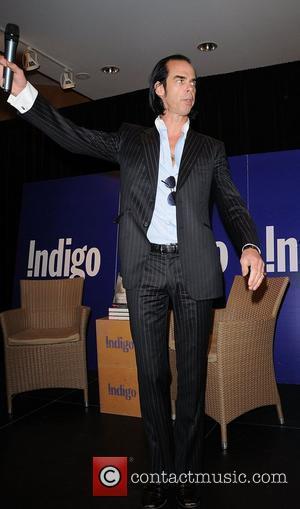 Nick Cave signs copies of his new book 'The Death of Bunny Munro' at Indigo Books in the Eaton Centre...