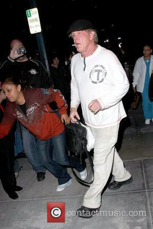 Nick Nolte leaving a medical building in Beverly Hills wearing a white sweatshirt and white trousers Los Angeles, California -12.11.09
