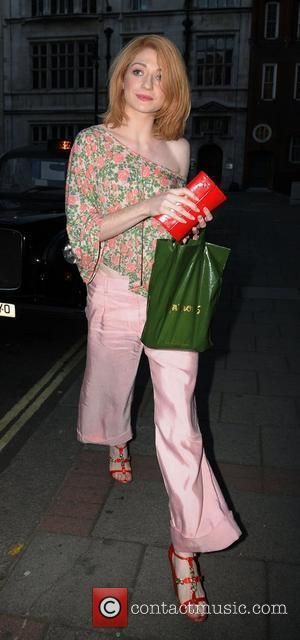 Girls Aloud singer Nicola Roberts wearing a pair of shiny pink trosuers and carrying a Harrods bag London, England -...