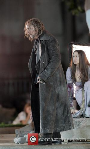 Nicolas Cage and Monica Bellucci film a romantic scene in The Sorcerer's Apprentice at a park in Manhattan. BSC.MWD.ZO7