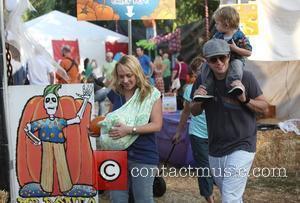 Nicole Sullivan and husband Jason Packham take their two sons Dashel Pierce and Beckett Edward Packham to Mr. Bones Pumpkin...