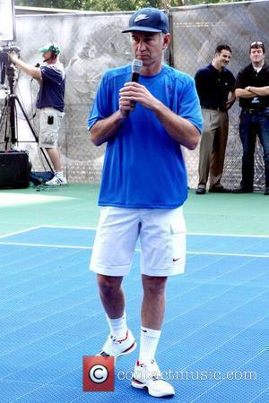 John McEnroe Nike Youth Tennis Challenge held at the Nike built regulation tennis court in the Flatiron District New York...