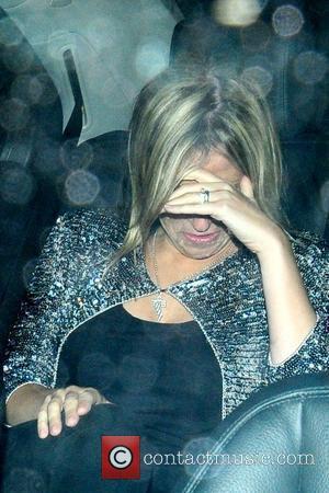 Nicole Appleton British singer leaving Nobu restaurant while covering her face London, England - 22.07.09