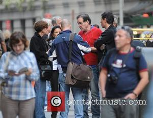Director Oliver Stone with his crew on the set of 'Wall Street 2: Money Never Sleeps' New York City, USA...