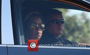 Oprah Winfrey driving with her bodyguard in Beverly Hills Los Angeles, California - 21.10.09