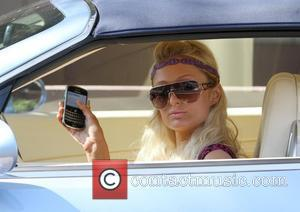 Paris Hilton, wearing a long batik dress, arrives in her Bentley for a meeting in Burbank Los Angeles, California -...