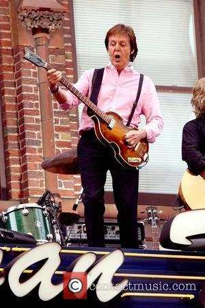 Paul McCartney performing live on the marquee of the Ed Sullivan Theater for CBS's 'Late Show with David Letterman.' McCartney...