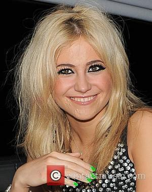 Pixie Lott leaves her single launch party, held at Sketch nightclub. Pixie appeared to be covering up her bad skin...