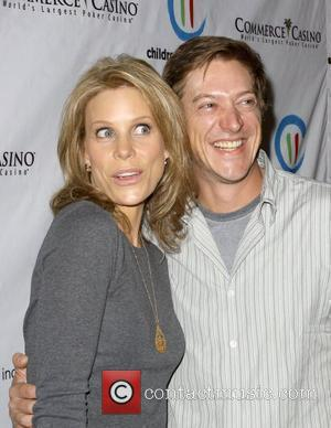 Cheryl Hines and Kevin Rahm