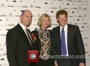 Prince Harry with Lawrence Dallaglio and wife Alice Dallaglio at the Cancer Research charity event in Battersea Park  London,...