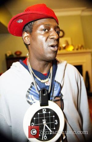 Flava Flav  Public Enemy at the Sasha Bruce House for Homeless Youth and hosts a Thanksgiving Dinner for homeless...
