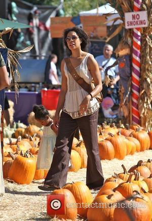 Gina Torres and daughter Delilah Fishburn visit Mr. Bones Pumpkin Patch to select a pumpkin for Halloween Los Angeles, California...