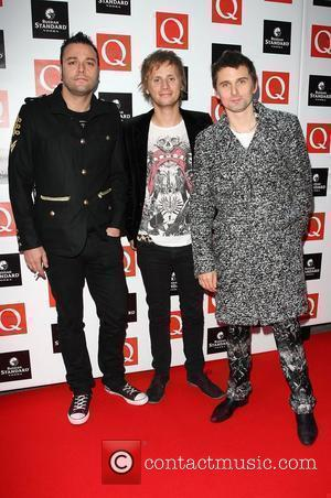 Christopher Wolstenholme, Dominic Howard and Matthew Bellamy of Muse The Q Awards 2009 - arrivals London, England - 26.10.09