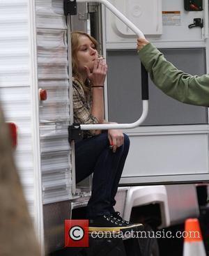 Emilie de Ravin having a cigarette break on the set of 'Remember Me' New York City, USA - 09.07.09