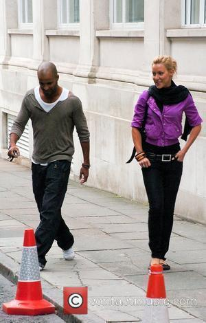 Ricky Whittle  with his 'Strictly Come Dancing' professional dance partner Natalie Lowe, practising his dance moves on the street,...