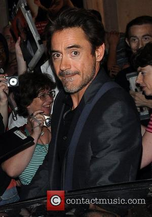 Robert Downey Jr. and his wife Susan Levi leave the Wyndham's Theatre after watching Jude Law perform in 'Hamlet' London,...