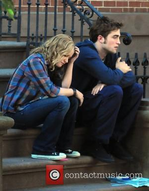 Emilie de Ravin and Robert Pattinson filming on the set of their new film 'Remember Me'. New York City, USA...