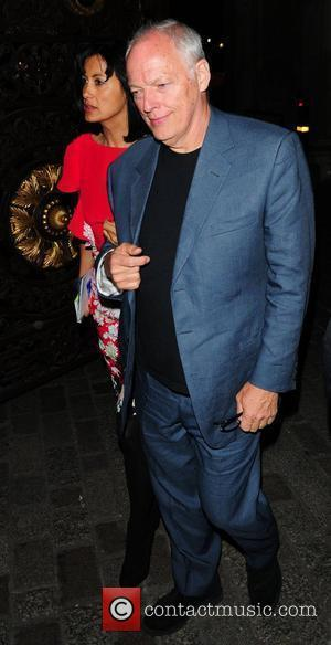 Dave Gilmour and guest attend the Royal Academy of Arts Summer Exhibition Preview Party 2009 at Royal Academy of Arts...