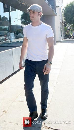 Ryan Gosling running errands while wearing a gray hat Los Angeles, California - 29.10.09